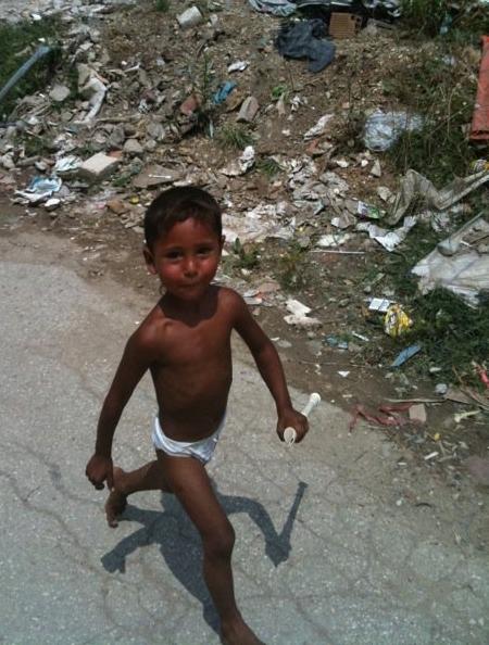 Roma boy in dump
